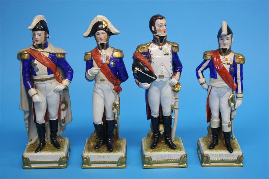 Lot 37 - A set of eight German porcelain military figures stamped Made in GDR; four Capo Di Monti figures and