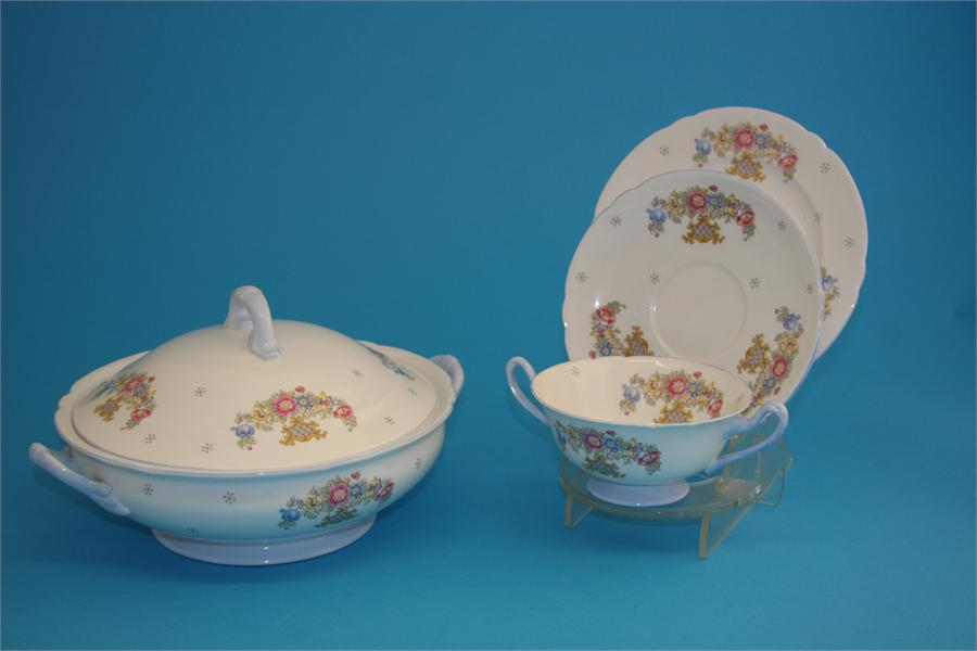 Lot 14 - A Shelley porcelain dinner service decorated with floral sprays, comprising gravy boat, 3 meat