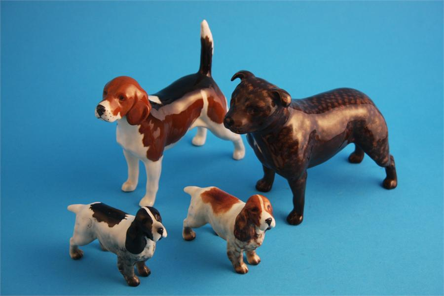 """Lot 29 - A Beswick Staffordshire bull terrier """"Bandits Brintiga"""" 1982A, two spaniels and a beagle """"Wendover"""