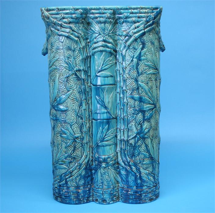 Lot 39 - A large Burmantoft's Faience umbrella/stick stand with relief moulded decoration in the oriental