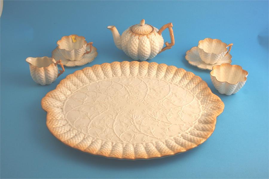 Lot 32 - A Belleek tea service comprising large oblong tea tray, teapot, 2 cups and saucers, cream jug and