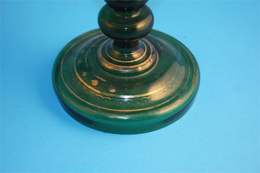 Lot 49 - A Victorian green glass spill vase with flared rim, the centre depicting an oval painted portrait of