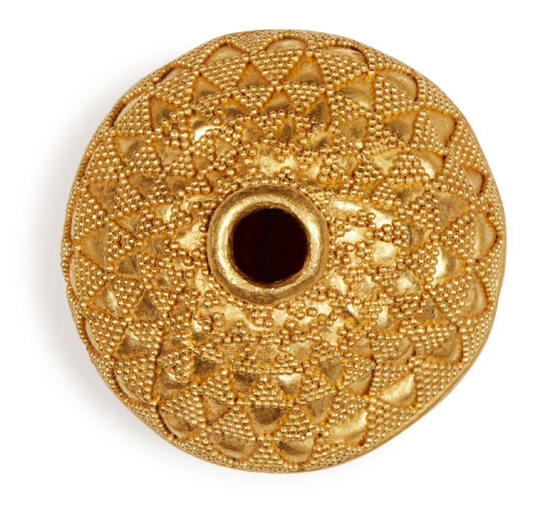 Lot 106 - A large gold bead with filigree decoration, of spherical form, decorated in two halves with