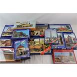 Collection of 16 boxed and unmade Pola model kits and buildings to include 401, 617, 671, 567,