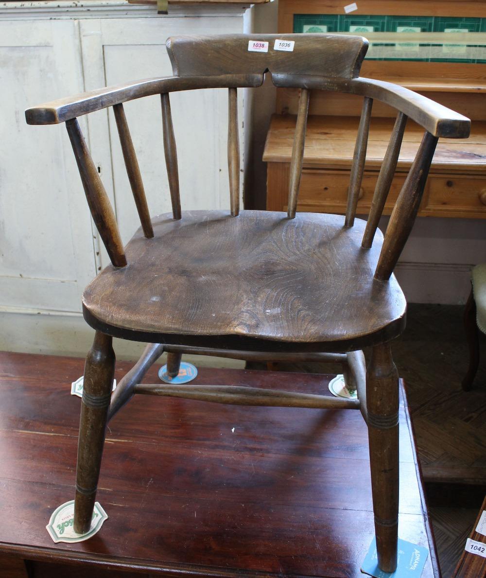 Lot 1036 - An elm Captain's chair