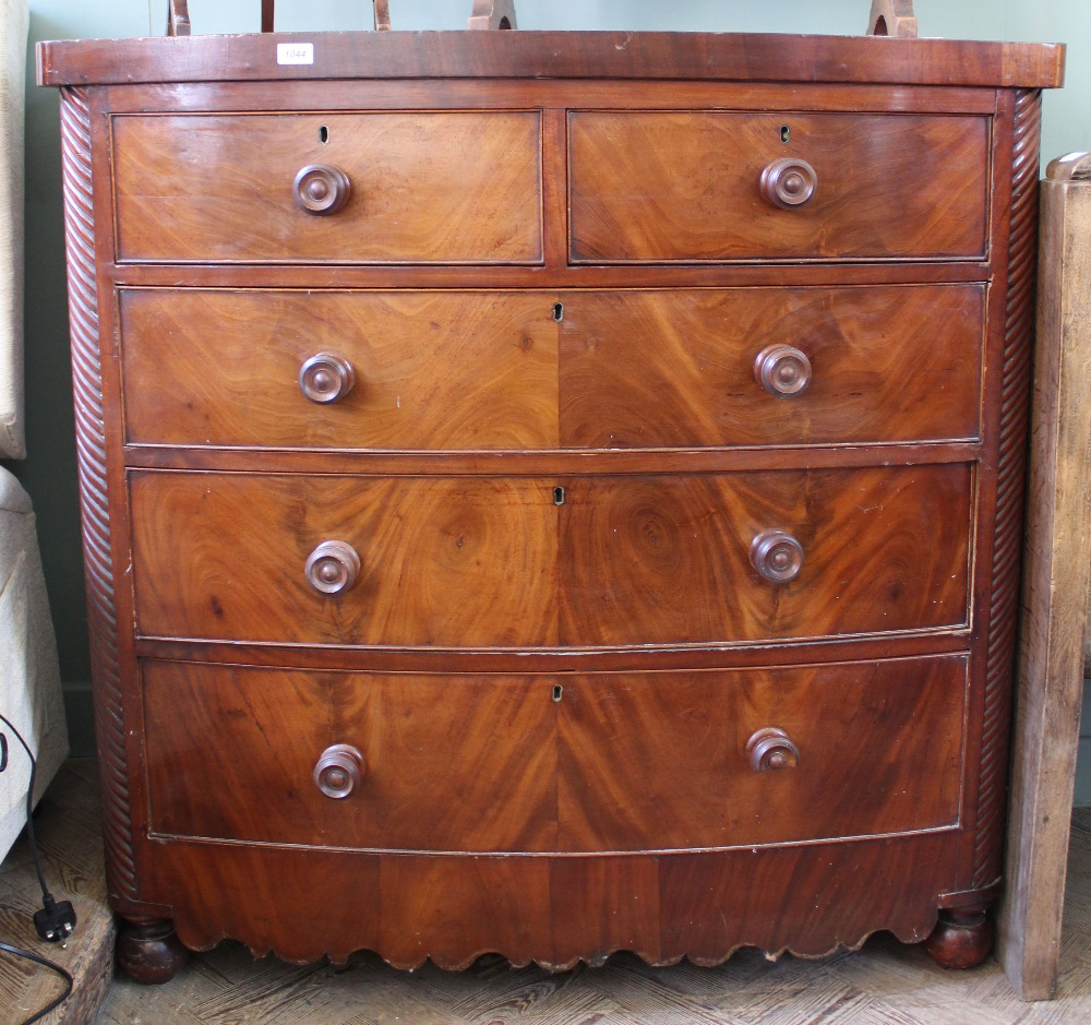 Lot 1044 - A 19th Century mahogany bow front chest of two short and three long drawers,