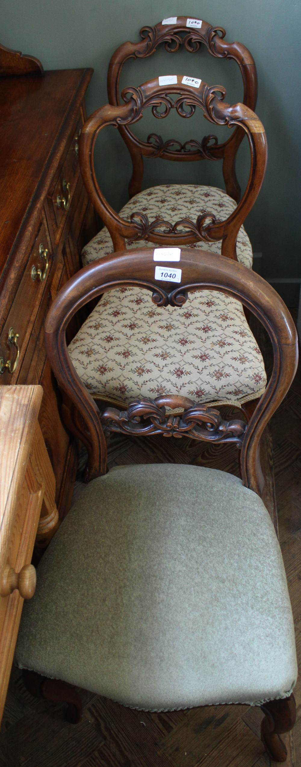 Lot 1040 - A pair of Victorian mahogany balloon back dining chairs and one other