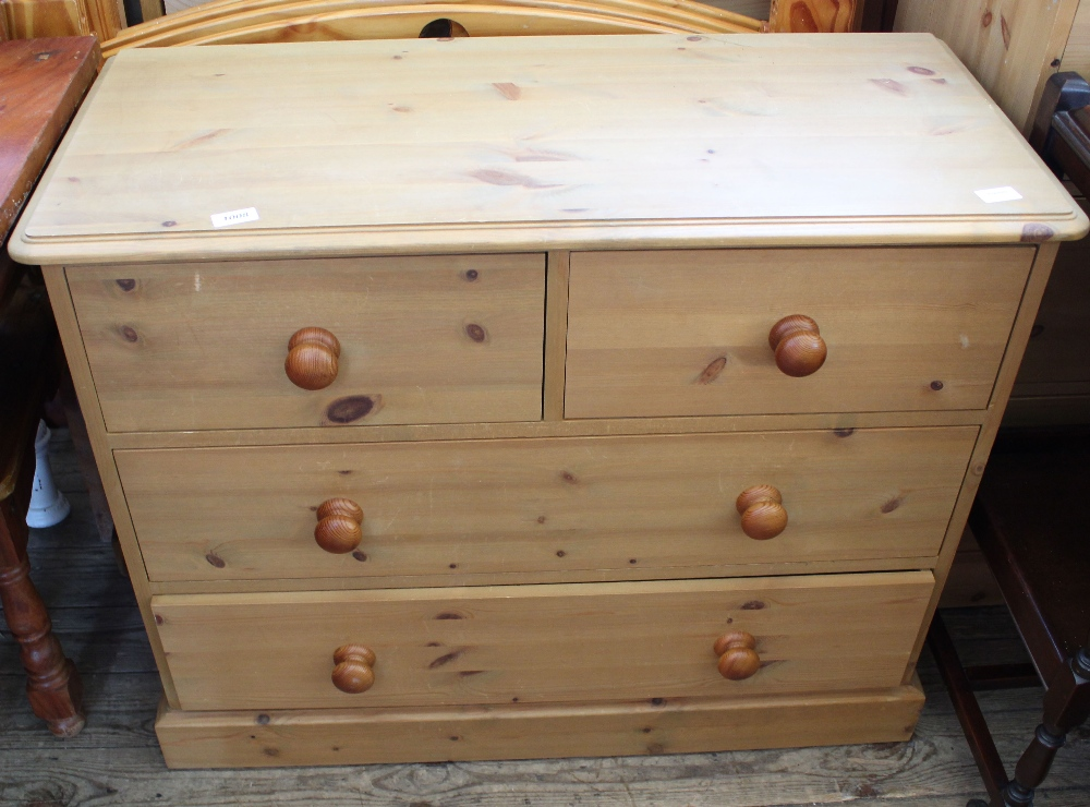 Lot 1008 - A pine chest of two short and two long drawers