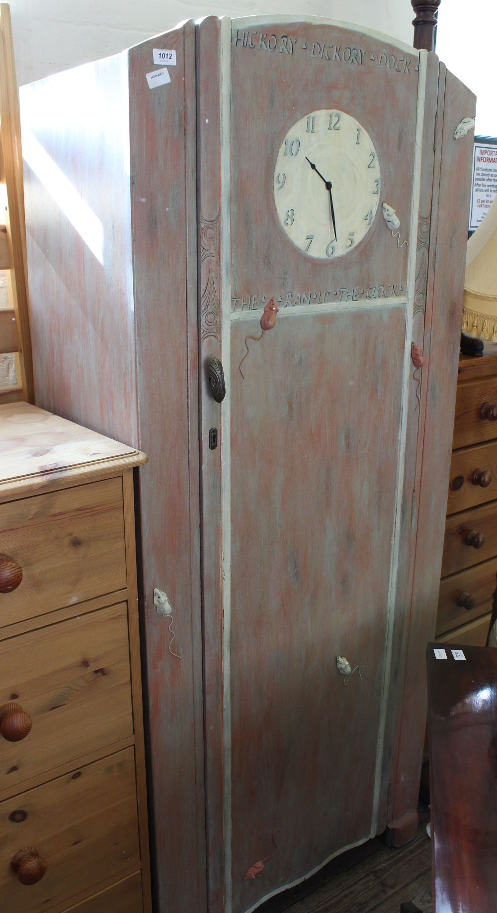 Lot 1012 - A child's wardrobe painted in nursery rhyme Hickory Dickory Dock theme