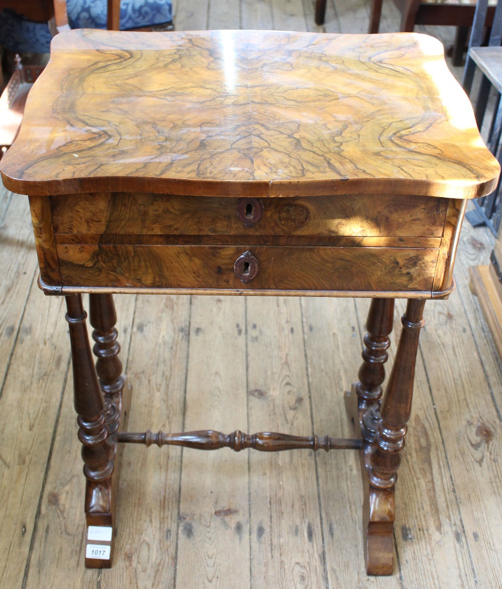 Lot 1017 - A 19th Century French burr walnut two drawer workstand with satinwood lined drawers and original