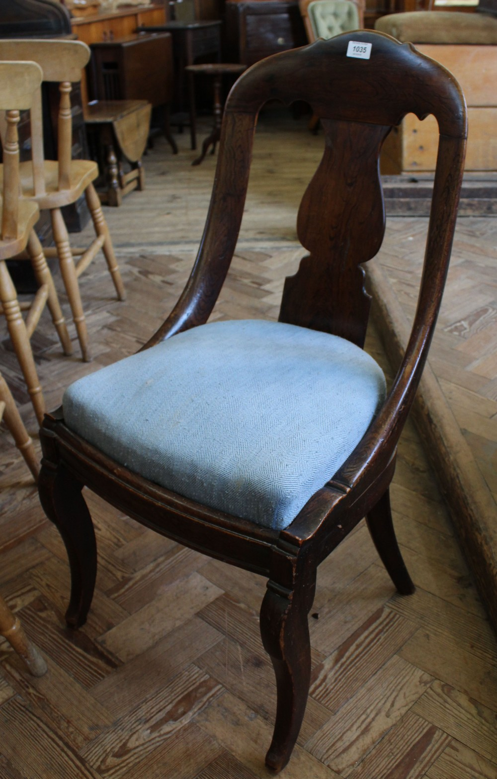Lot 1035 - A grained mahogany single chair