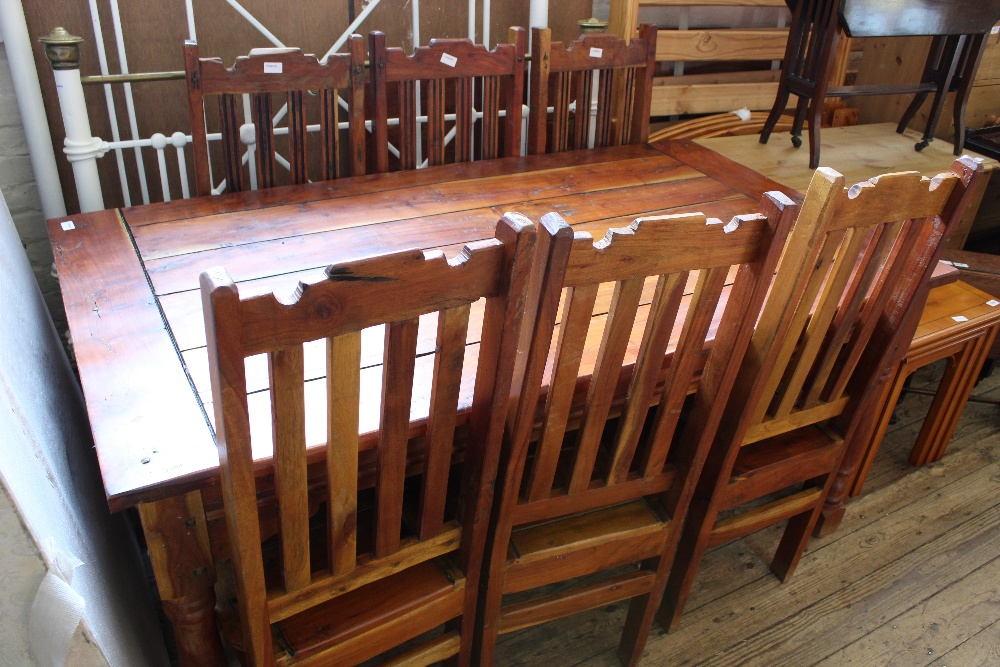 Lot 1004 - A rustic style kitchen table and six metal chairs