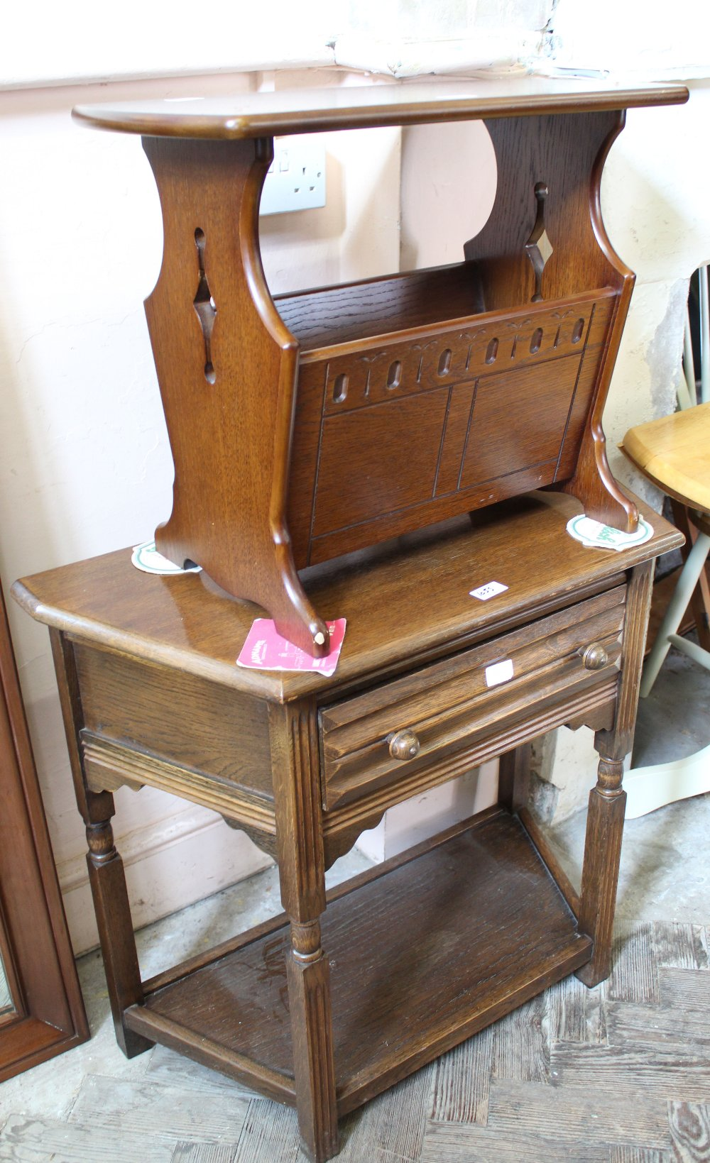 Lot 1055 - An Old Charm magazine rack and single drawer side table