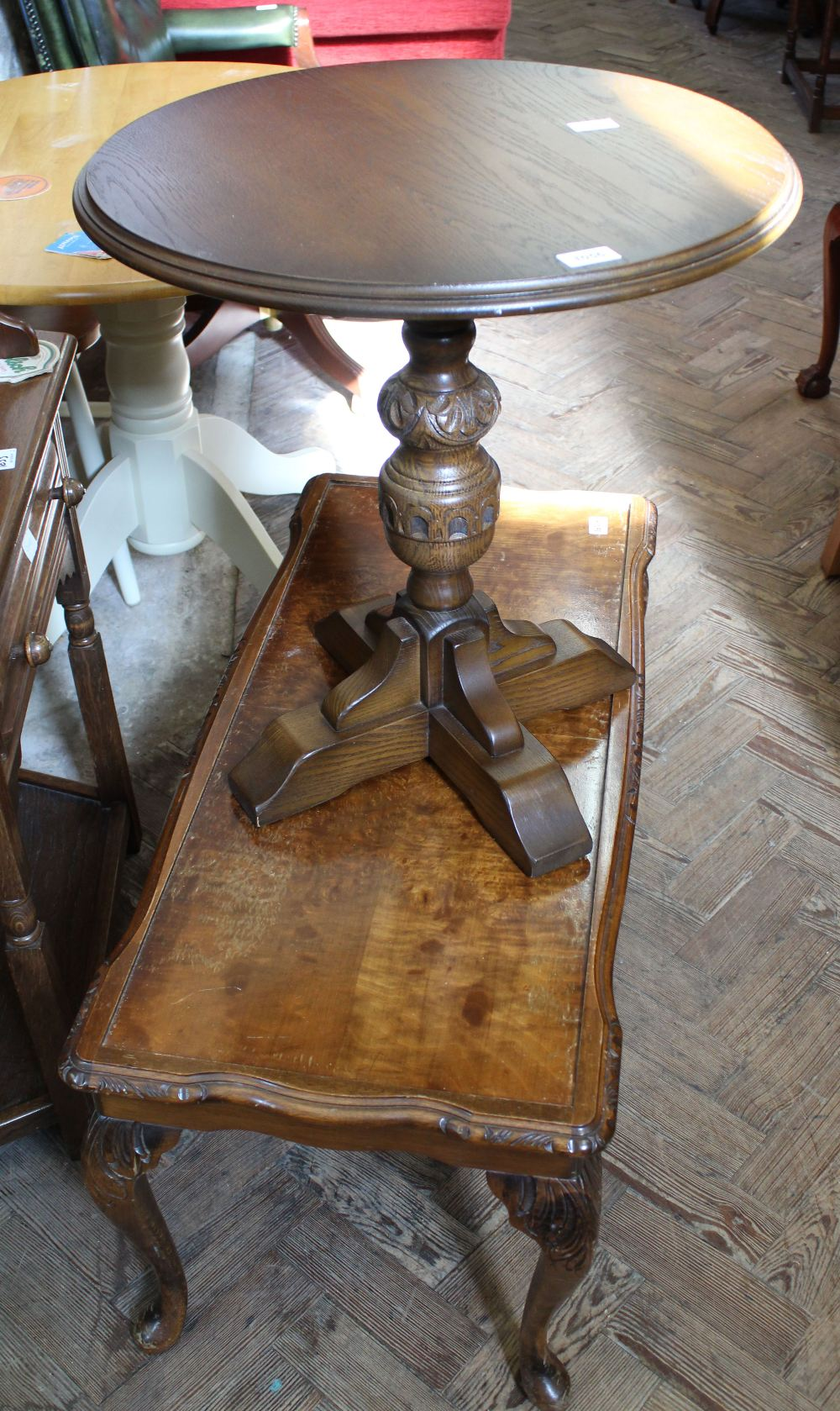 Lot 1056 - An Old Charm oak circular occasional table and a rectangular coffee table