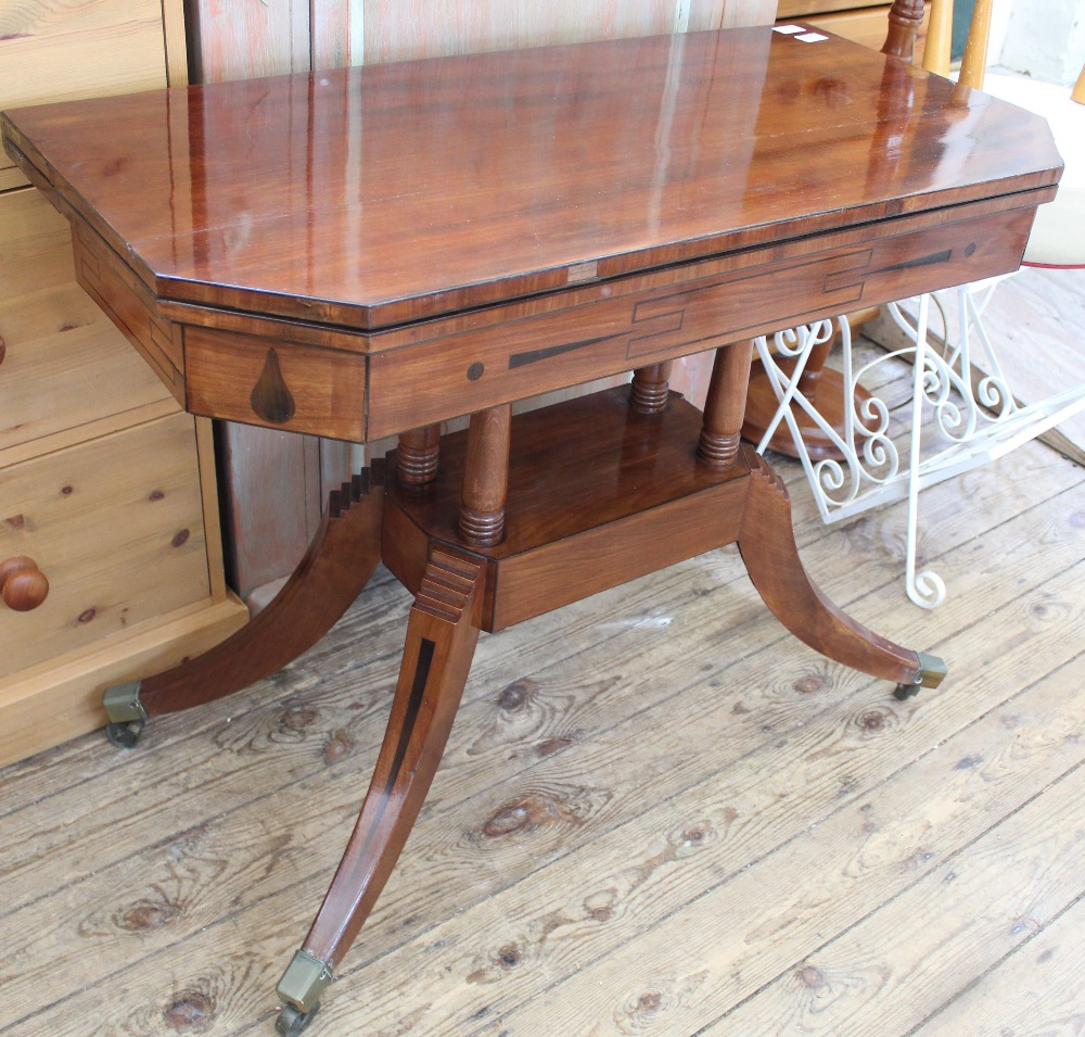 Lot 1013 - A William IV inlaid mahogany games table on brass casters