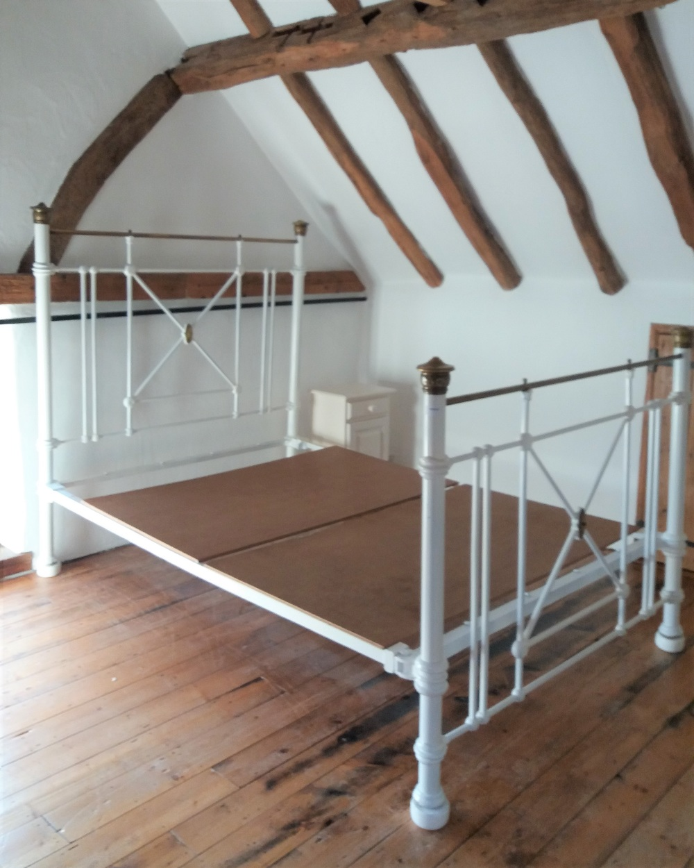 Lot 1002 - A white painted and brass double bed frame