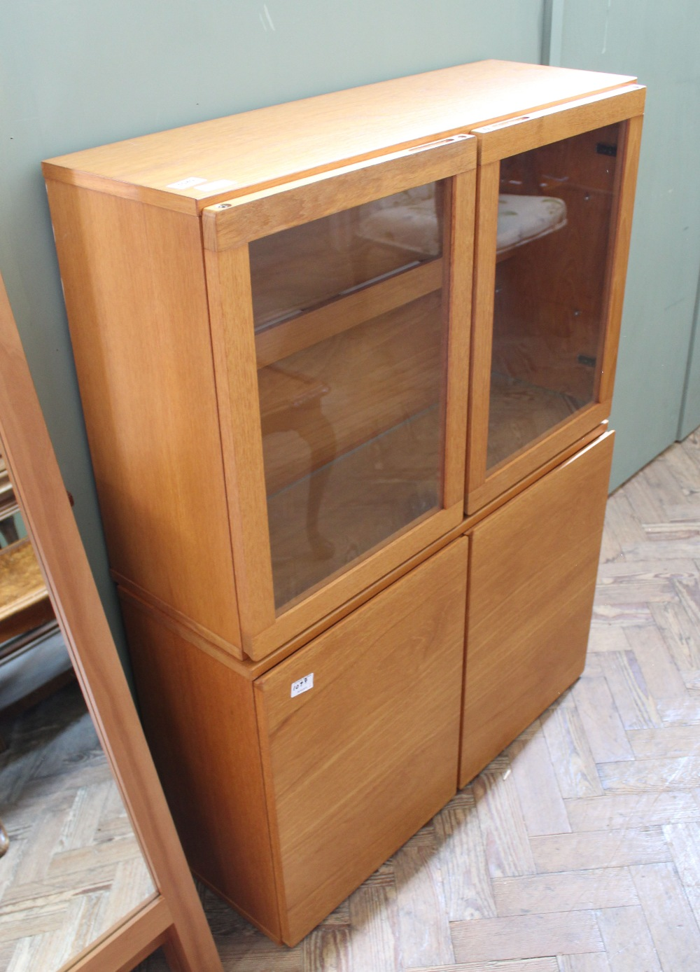 Lot 1049 - Two teak display cabinets