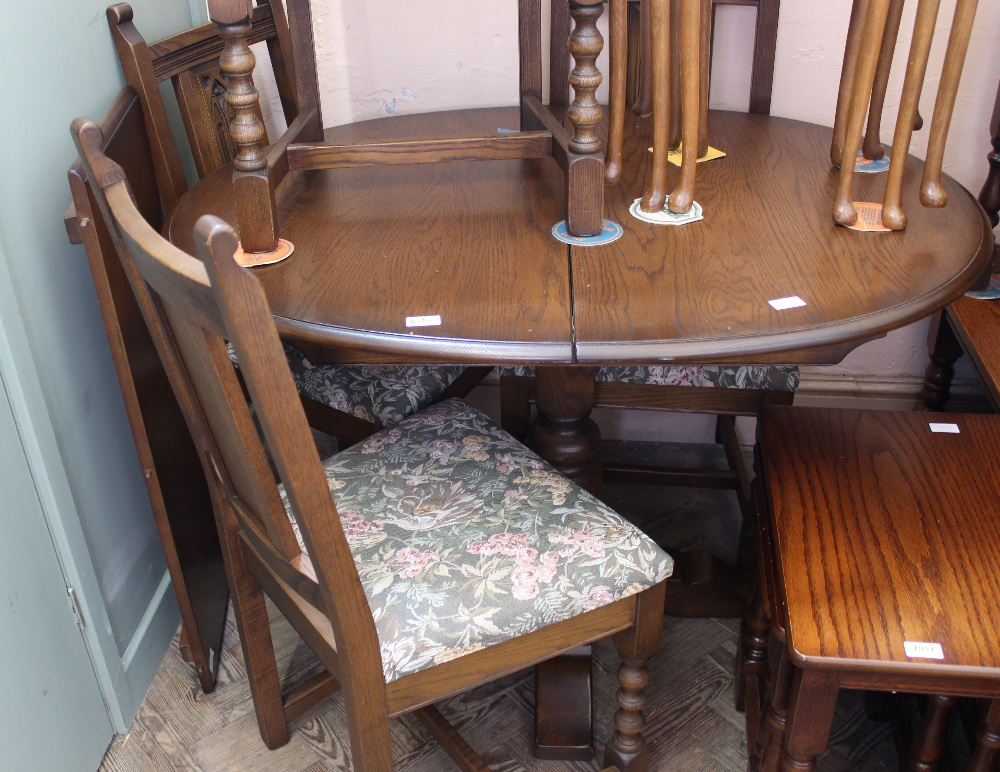 Lot 1050 - An Old Charm extending oak dining table and four chairs