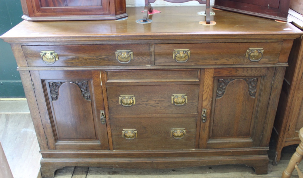 Lot 1020 - A large Edwardian oak five drawer,