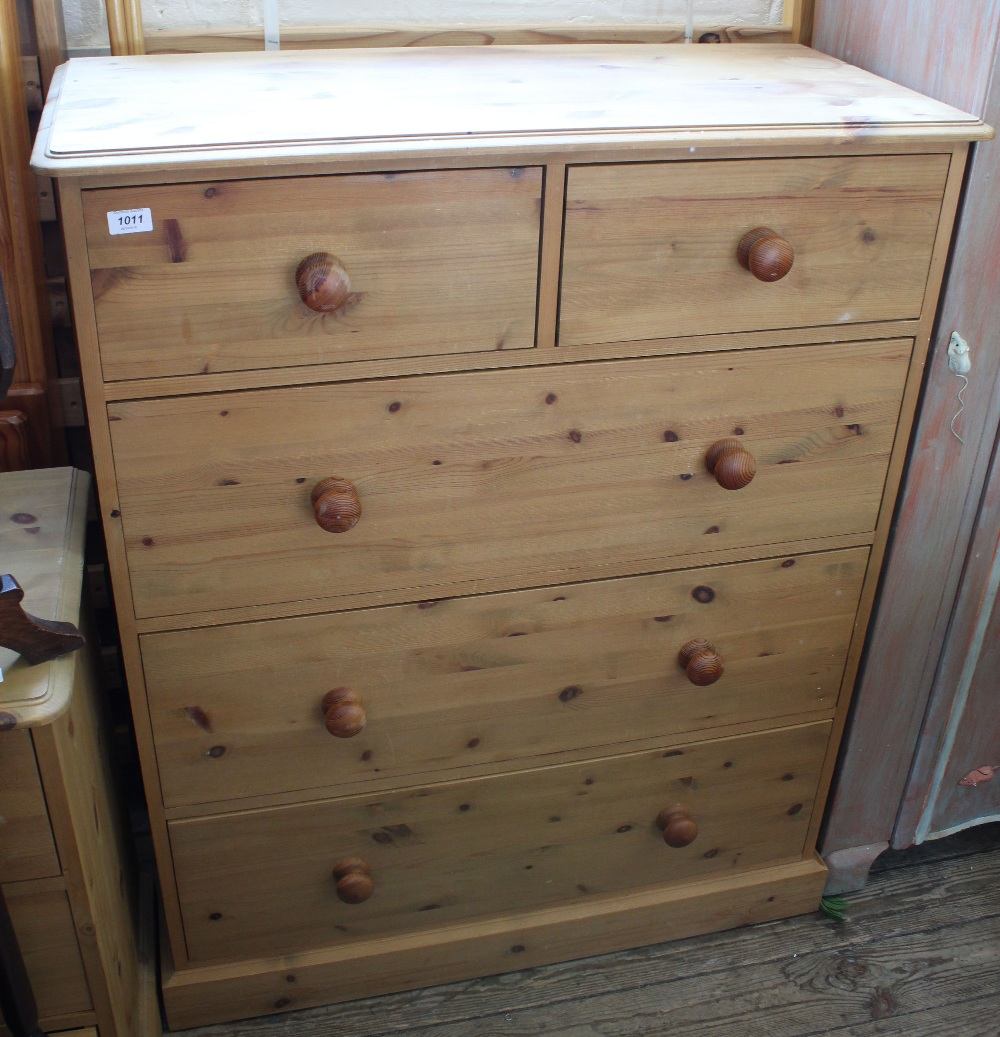 Lot 1011 - A pine chest of two short and three long drawers