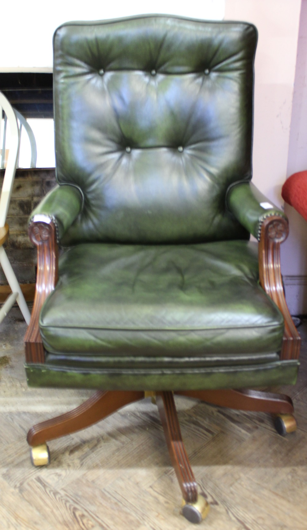 Lot 1058 - A reproduction mahogany and leather upholstered office chair