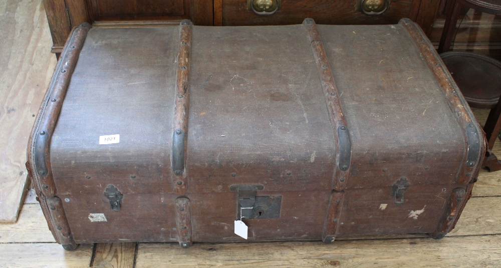 Lot 1021 - A large canvas steamer trunk