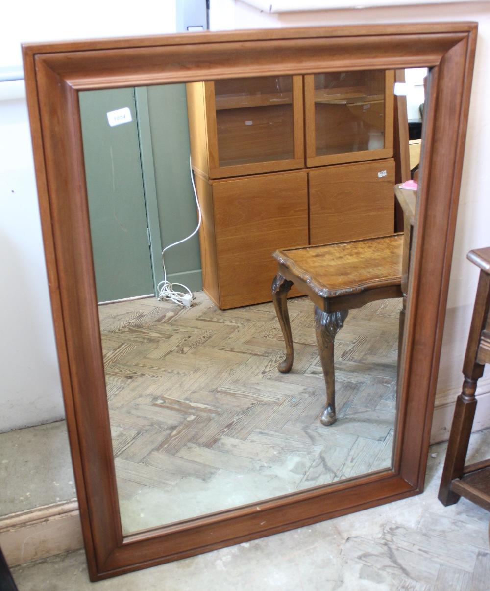 Lot 1054 - A large rectangular mahogany effect wall mirror