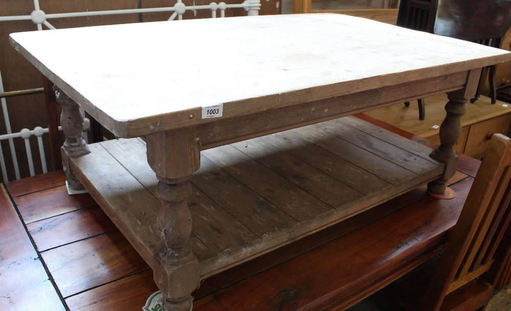 Lot 1003 - A stripped pine coffee table with under tier