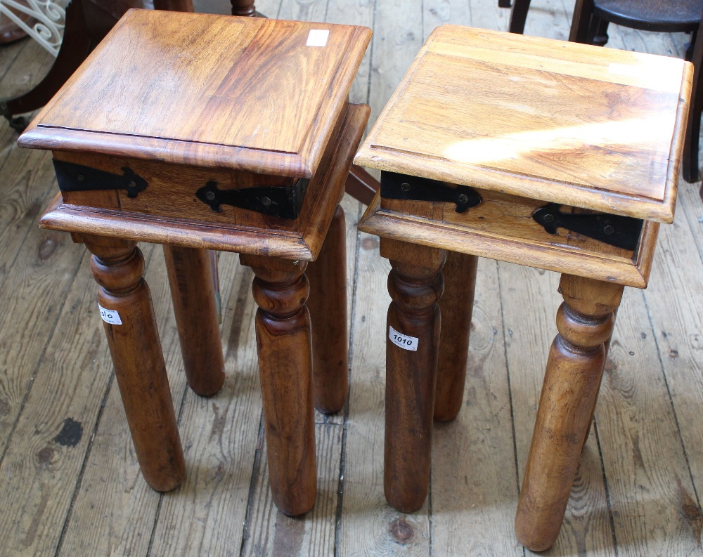 Lot 1010 - A pair of hardwood and metal bound occasional tables