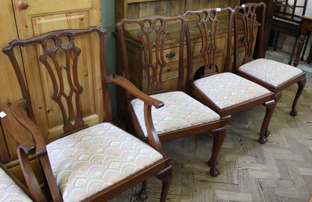 Lot 1045 - A set of six Chippendale style dining chairs (including two carvers)