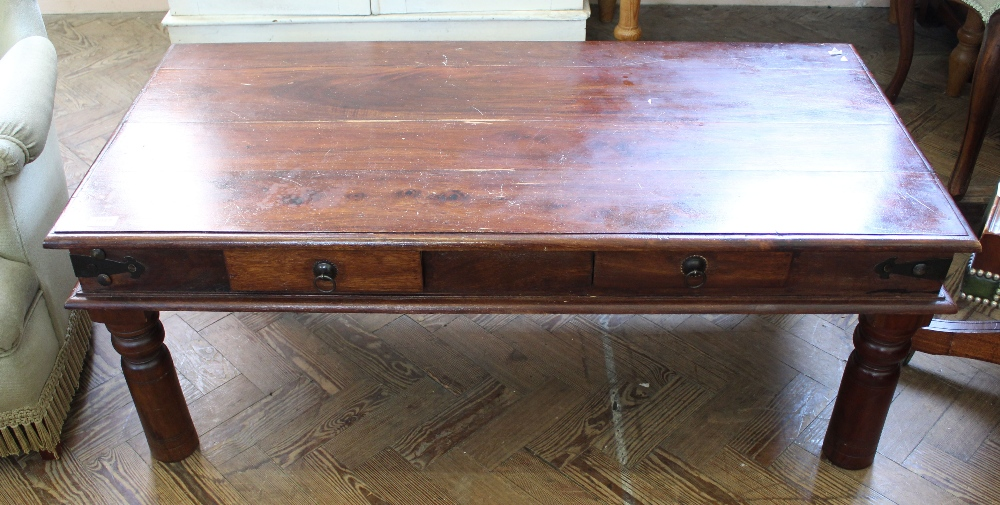 Lot 1037 - A mangowood and black metal bound two drawer coffee table