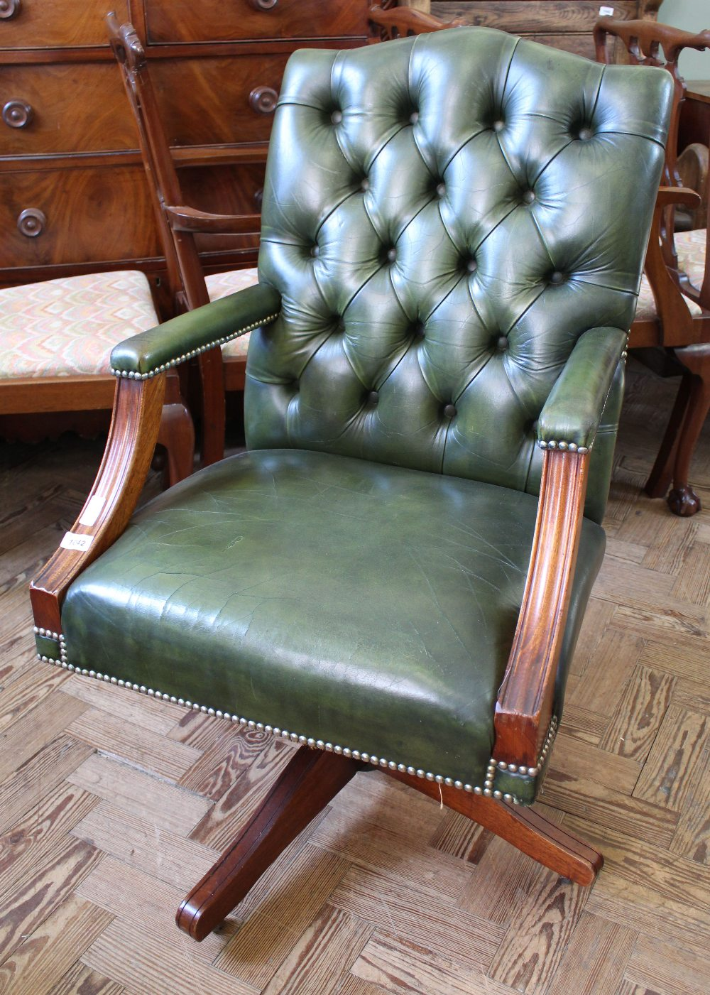 Lot 1042 - A reproduction mahogany and green leather back office chair