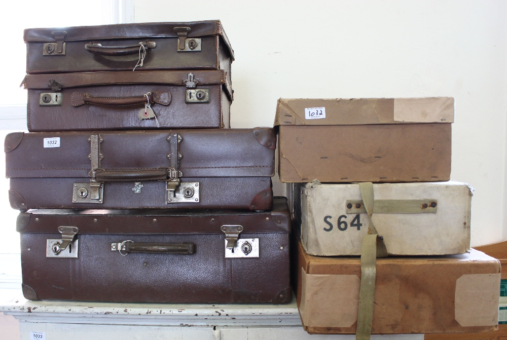 Various vintage leatherette suitcases and cardboard storage boxes