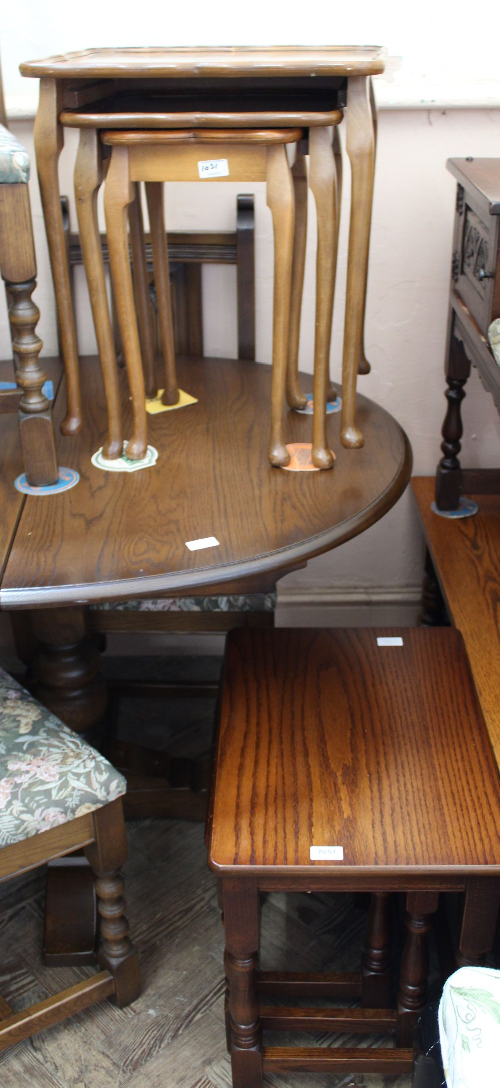 Lot 1051 - An Old Charm nest of three oak tables and one other nest of tables