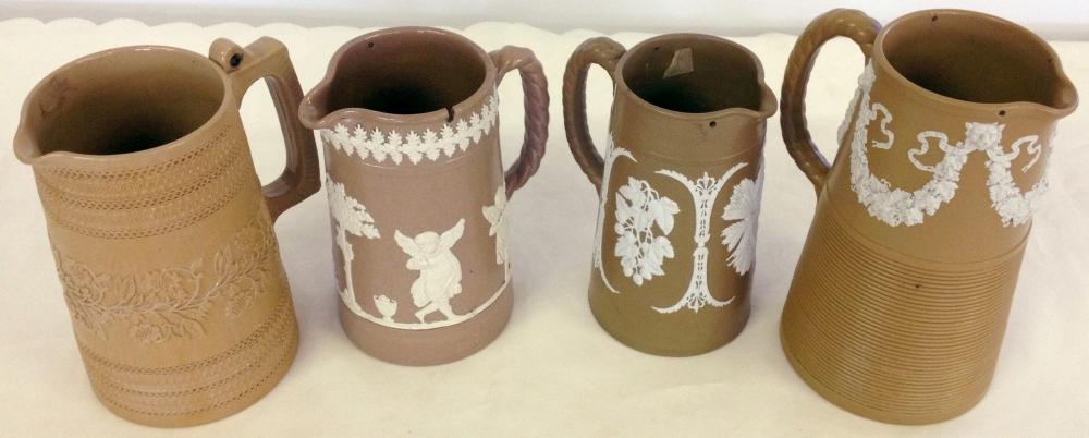 3 19th century Dudson brown & white Jasperware jugs with a Copeland jug.