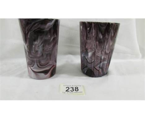 A Victorian Davidson pressed purple slag glass tumbler with smooth outside (11.5 cm) and a Victorian Davidson pressed purple