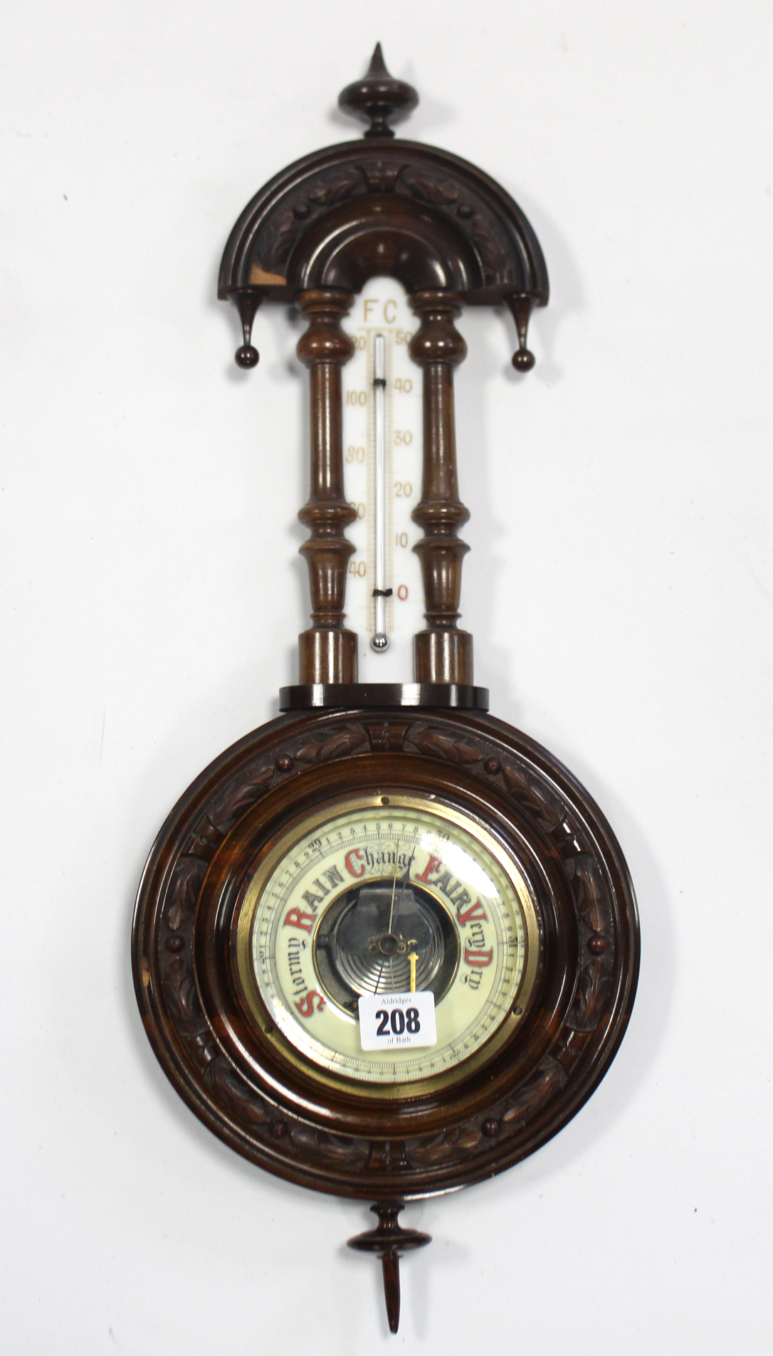 """Lot 260 - An aneroid wall barometer in carved walnut banjo-style case, 22"""" high; together with nine various"""