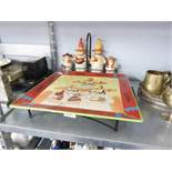 SET OF FOUR MEXICAN FIGURE SAUCE BOTTLES AND HOLDER AND A LARGE PLATE AND TRAY.