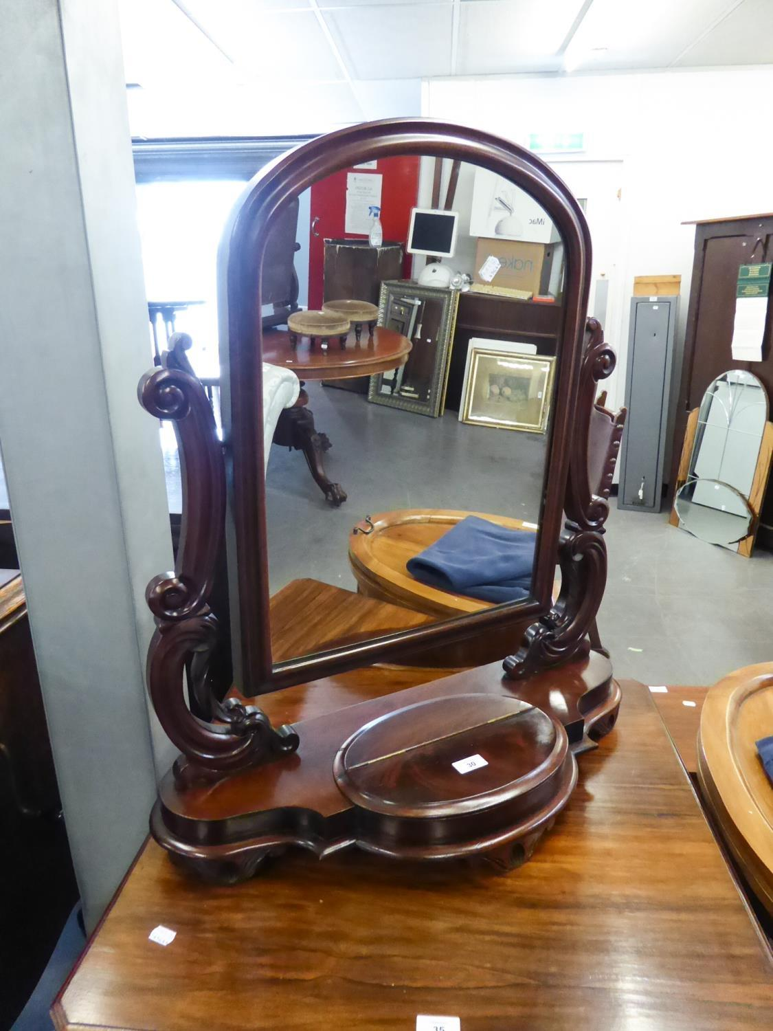 A VICTORIAN MAHOGANY SHAPED SWING TOILET MIRROR, SCROLL ARM SUPPORTS OVER CENTRAL DRAWER TO THE BASE