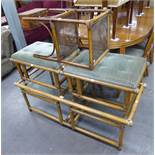 A LARGE BAMBOO COFFEE TABLE WITH GLASS TOP, A PAIR OF SIMILAR BAMBOO FOOTSTOOLS WITH UPHOLSTERED