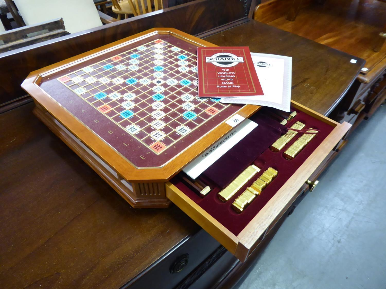 A DELUXE SCRABBLE COLLECTORS EDITION BOARD GAME, COMPLETE WITH 22CT GOLD PLATED LETTER TILES AND