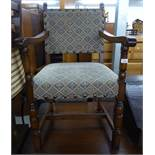 A SET OF FIVE OAK DINING CHAIRS OF COMMONWEALTH STYLE, WITH UPHOLSTERED BACK PANELS AND STUFFED OVER