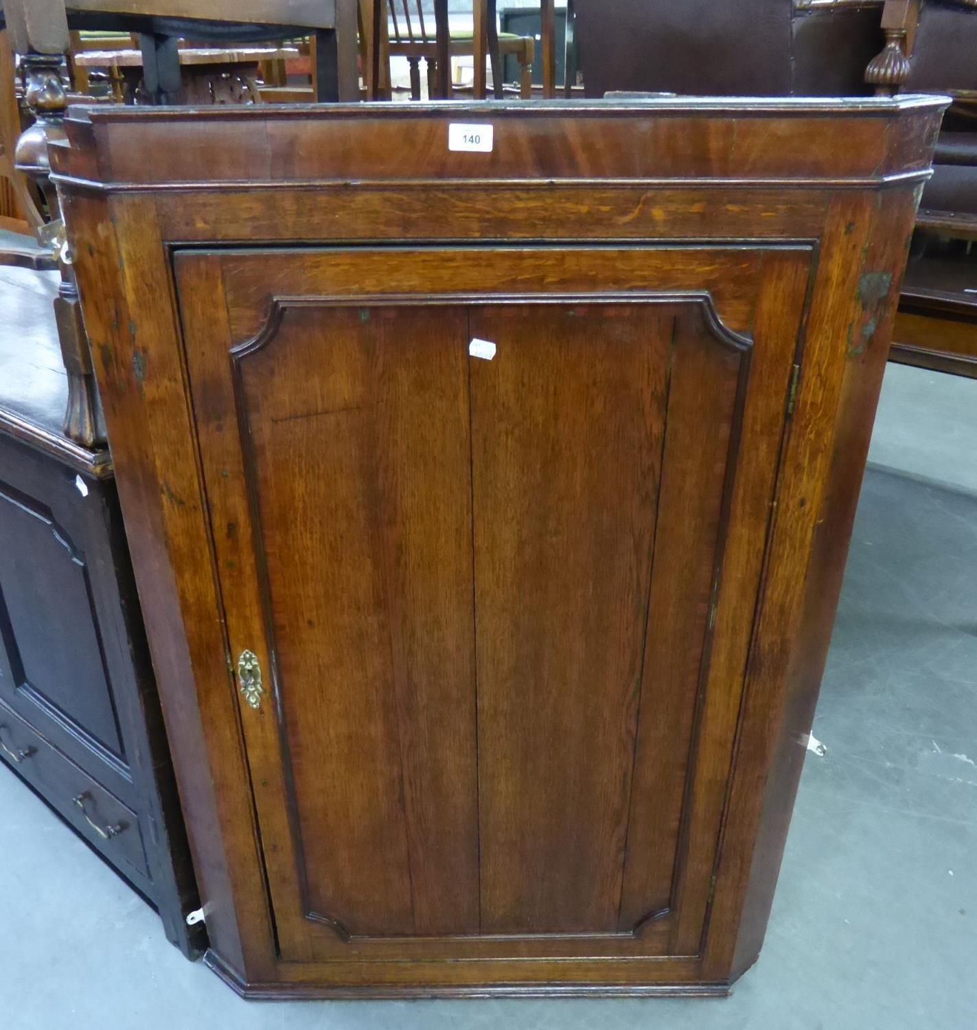 A LARGE GEORGE III OAK AND MAHOGANY CROSSBANDED HANGING CORNER CUPBOARD