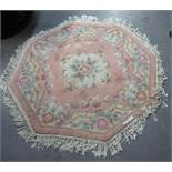 AN OCTAGONAL CHINESE RUG, PINK GROUND, OF AUBUSSON FLORAL DESIGN