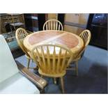 A BEECHWOOD CIRCULAR EXTENDING DINING TABLE, WITH HEATPROOF TOP, WITH FOLDING LEAF BELOW, ON