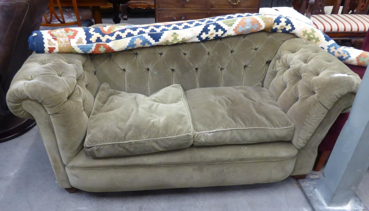 A VICTORIAN CHESTERFIELD SOFA HAVING BUTTON BACK AND ARMS, HAVING DROP ARM TO ONE END, IN GREEN