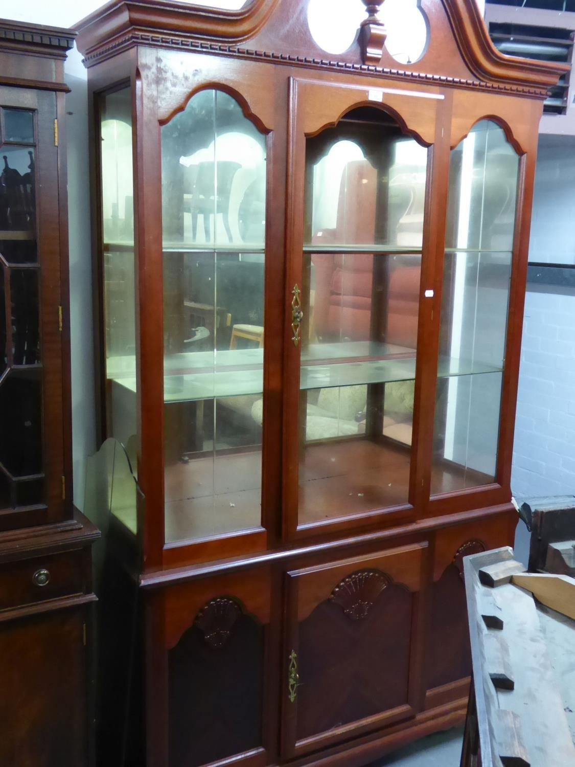 GEORGIAN STYLE MAHOGANY DISPLAY CABINET WITH BROKEN ARCH PEDIMENT, MIRRORED INTERIORS, CUPBOARD BASE - Image 2 of 2