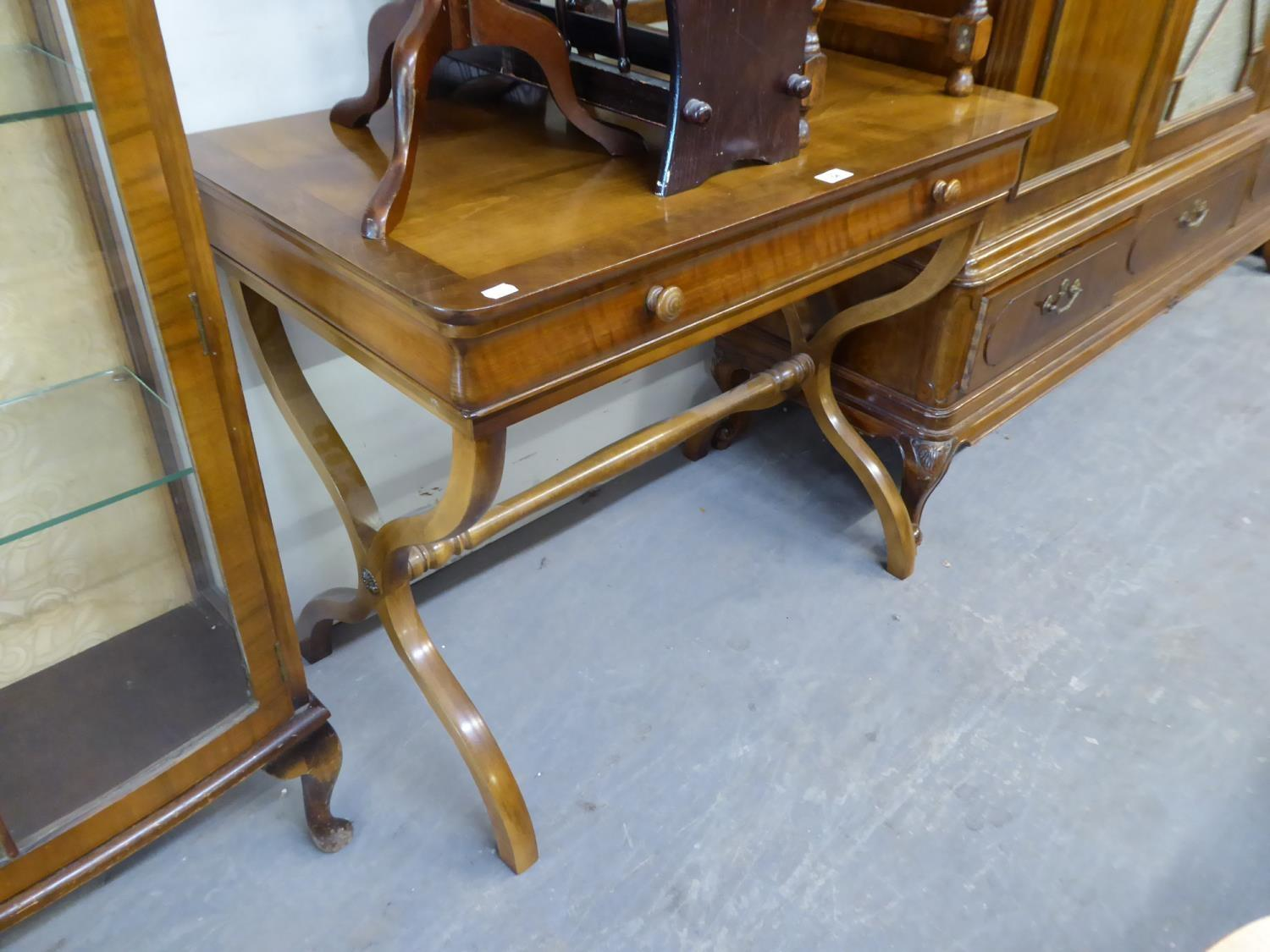 "A MAHOGANY SIDE TABLE WITH ONE LONG DRAWER, RAISED ON ""X"" SHAPED SUPPORTS"