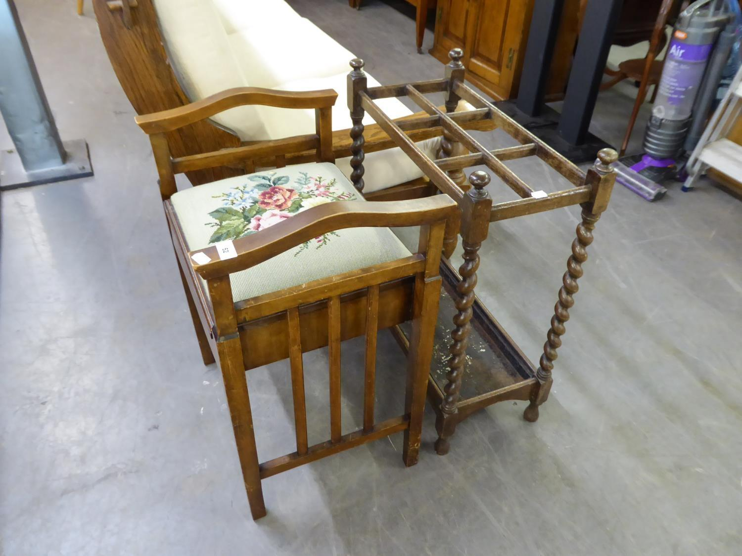 A PIANO STOOL WITH FLORAL TAPESTRY SEAT AND A STICK STAND ON BARLEY TWIST SUPPORTS