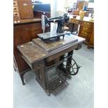 SINGER SEWING MACHINE in walnutwood cabinet AND ANOTHER SINGER SEWING MACHINE detached from oak base